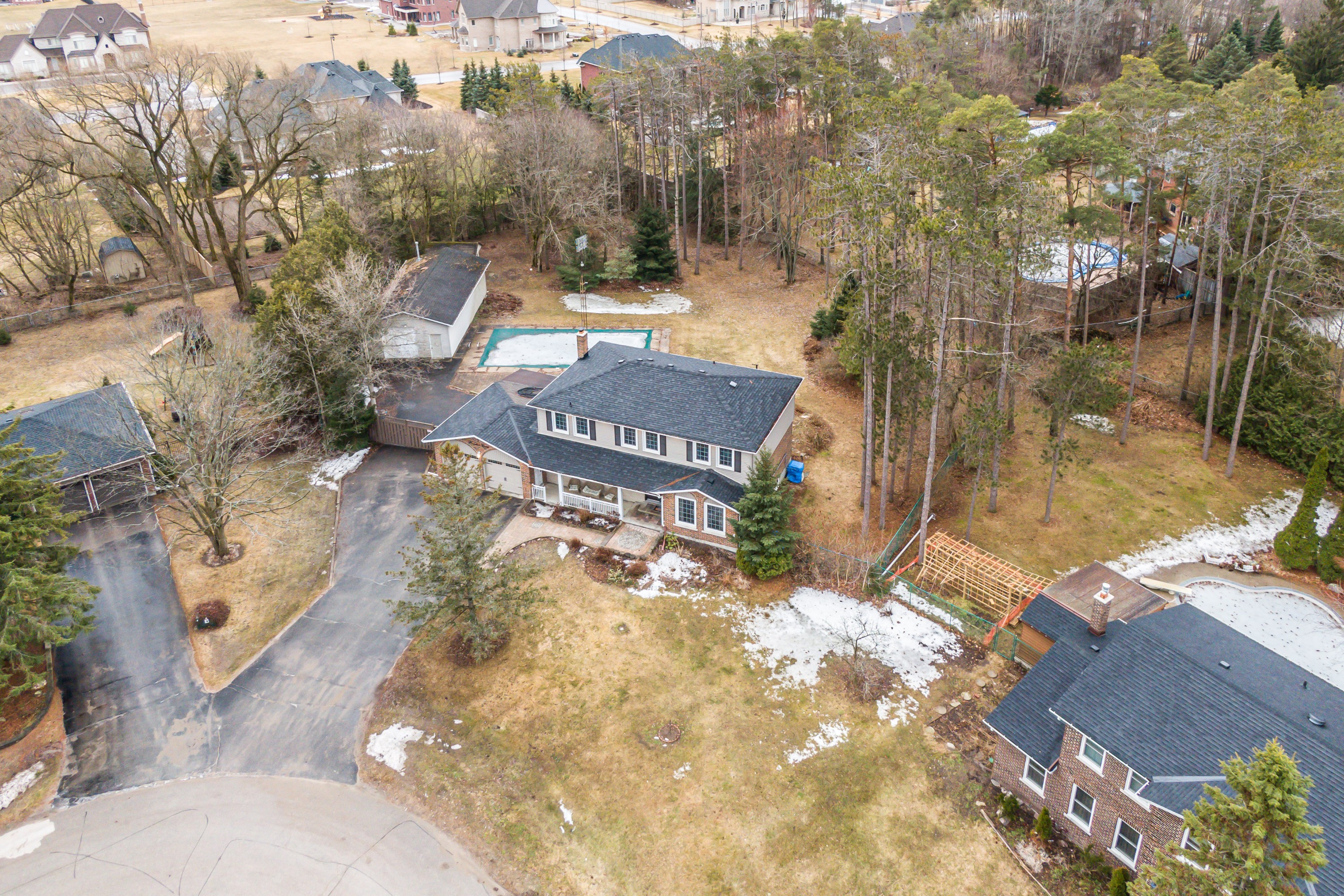 Spectacular Renovated Home On A 3/4 Acre Lot Complete With A Salt-Water Pool & Workshop!