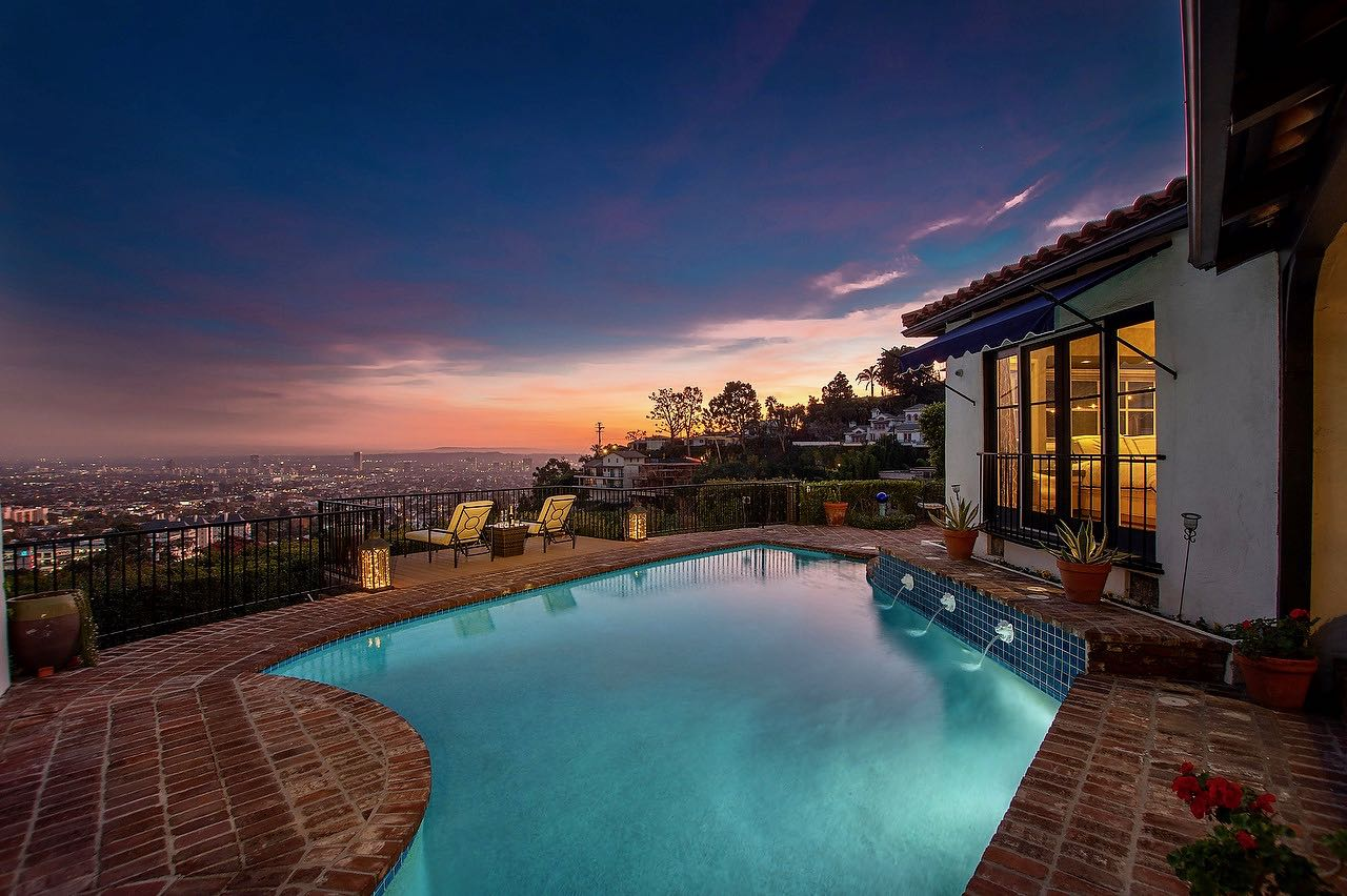 Enchantment abounds in this magnificent Mediterranean villa with spectacular views, pool, large grassy yard and more!