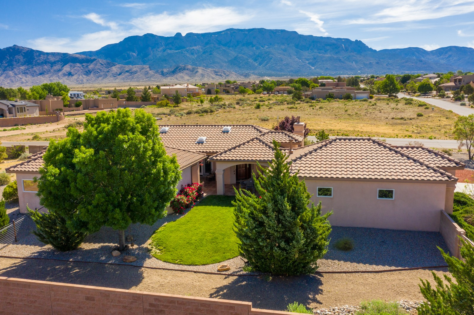 Single Owner Custom Homes - city water/sewer and underground utilities in North ABQ Acres